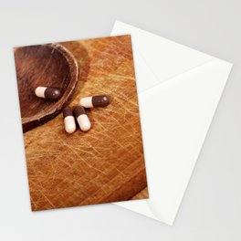 Suplement pills on wooden spoon Stationery Cards