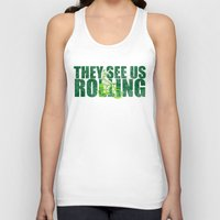 seahawks Tank Tops featuring They See Us Rolling - Seattle Seahawks Michael Bennett on a Bicycle by Madeline Timm