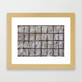Iron in the wall Framed Art Print
