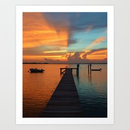 Fire & Ice or Hot & Cold, either describe the Red & Blue colors of the Sunset that split the bay. Art Print