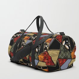 A complex patchwork in black and orange colors . Duffle Bag