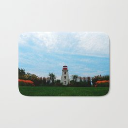 Garden and Lighthouse at the bottle houses Bath Mat