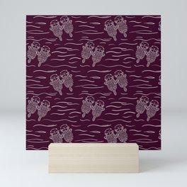 Sea Otters on Dark Raspberry Mini Art Print