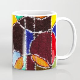 A carpet with an abstract pattern made by hands. Coffee Mug