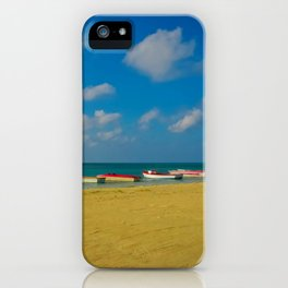 Colorful Boats Adorn the Tranquil Beach iPhone Case