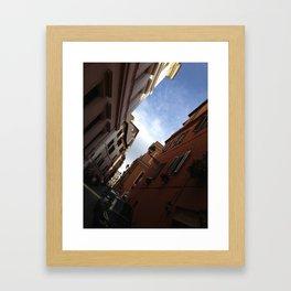 a glimpse of the colliseum  Framed Art Print