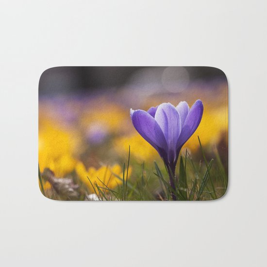 Crocus in a meadow Bath Mat