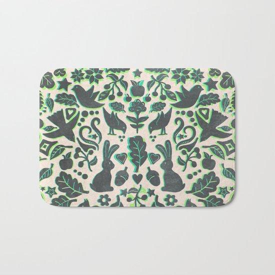 Two Rabbits - folk art pattern in grey, lime green & mint Bath Mat