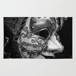 Close-up of a Venetian carnival mask with black and silver white ornaments Rug