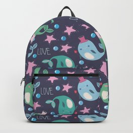 seamless pattern with the image of cute whales in hats, stars and bubbles on a dark background Backpack