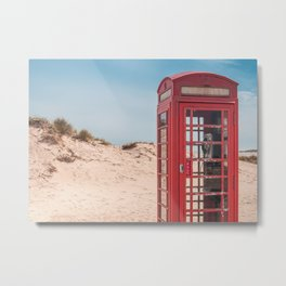 A vintage British red telephone box in the sand dunes of a deserted beach Metal Print