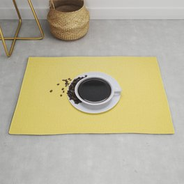 Black Cup of Coffee with Coffee Beans on Yellow Rug