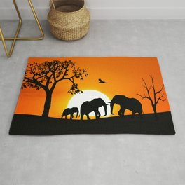 Elephant silhouettes at sunset Rug