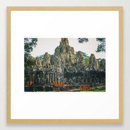 Unidentified Buddist monks from Thailand at one of the temple of Bayon Temple .Buddhism is currently Framed Art Print