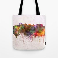 oakland Tote Bags featuring Oakland skyline in watercolor background by Paulrommer