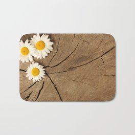 Daisies on wooden background Bath Mat