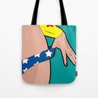 superheroes Tote Bags featuring superheroes by mark ashkenazi
