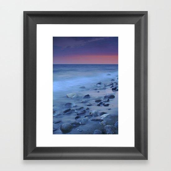 Blue stones at the sea Framed Art Print