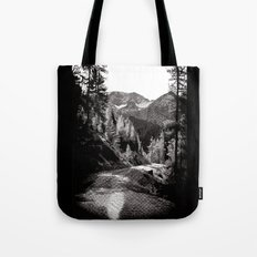 The road through the forrest below the mountains Tote Bag