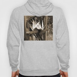 A striking exotic palm flower like a bird of paradise in sepia style Hoody