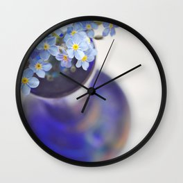 Blue Forget me nots in deep blue glass vase. Wall Clock