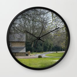 A view along a green woodland path lined with trees with a cottage at the end in North Yorkshire Wall Clock