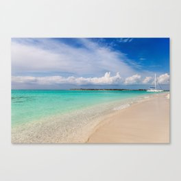 Catamaran on deserted white sand beach Canvas Print
