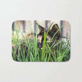 Cat in grass Bath Mat