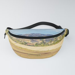 A football field on the mountains on the background A quiet and beautiful place for a football game Fanny Pack