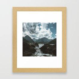 Mountains under cloudy sky Framed Art Print