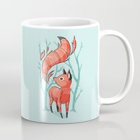 trees Mugs featuring Winter Fox by Freeminds