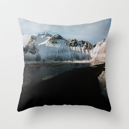 Aerial of a black beach at the ocean with Mountain in south Iceland during sunset - Landscape Photog Throw Pillow
