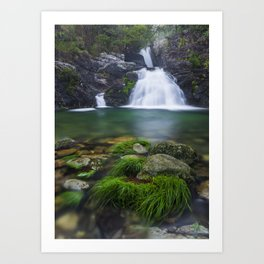 Cascade and lake of green colors in the middle of the forest in the north of Portugal. Art Print