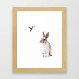 A bunny and bird Framed Art Print