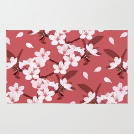 Sakura on red background Rug