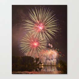 Rose, Yellow and Purple Fireworks over a Pond with Lilypads Canvas Print