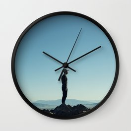 Alone in the blue summit Wall Clock