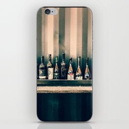 Grungy bar alcoholic drinks lineup on a wall iPhone Skin