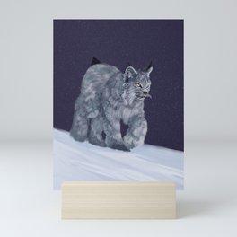 Lynx in a snowstorm Mini Art Print