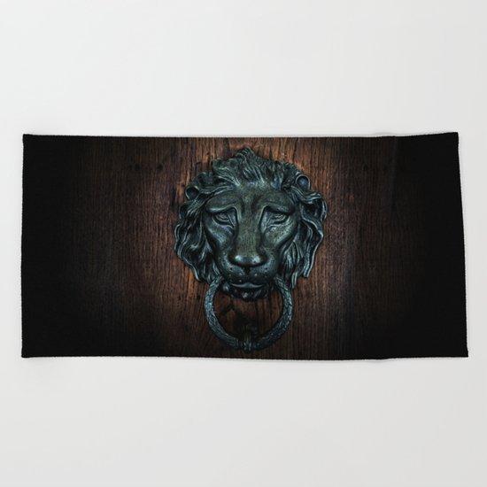 Vintage bronze lion door knocker Beach Towel