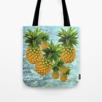 pineapples Tote Bags featuring Pineapples by Erika Kaisersot