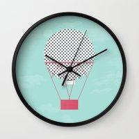 hot air balloon Wall Clocks featuring PINK HOT AIR BALLOON by Allyson Johnson