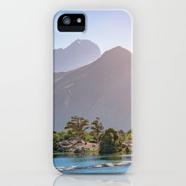 Mountain lake with blue water and a juniper tree in sunshine on a rocky mountain. Fann Mountains iPhone Case