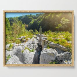 Extreme terrain eroded rock formation from waterhole landscape in France Serving Tray