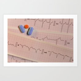 Colored pills on electrocardiogram strips Art Print