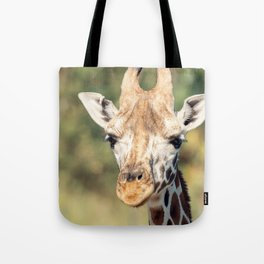 Giraffe outside in nature during the day. Tote Bag