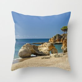 rock formation on Olhos d'Agua beach, Portugal Throw Pillow