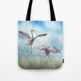 Pair of Sandhill Cranes  dance in the Florida wetlands Tote Bag