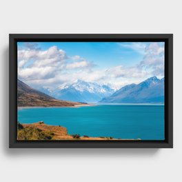Blue waters of Lake Pukaki with snow-capped Mount Cook in the background in New Zealand Framed Canvas