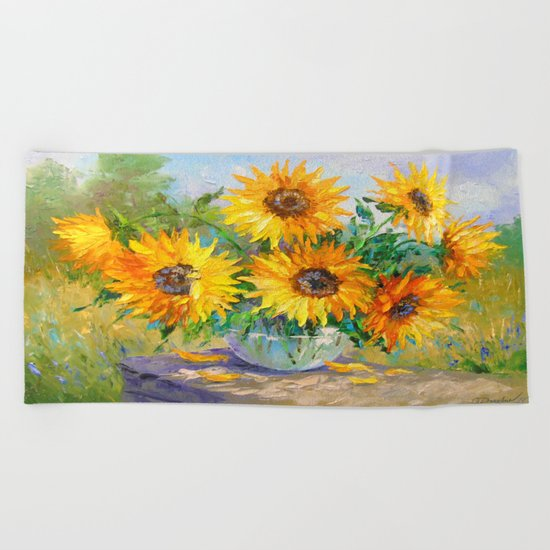 Bouquet of sunflowers on the table Beach Towel